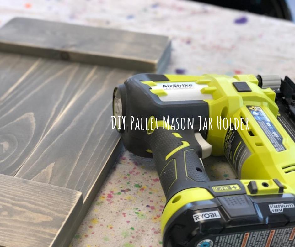 Using green Ryobi AirStrike brad nailer to make a pallet wall sconce.