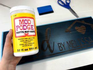 using mod podge to paint stenciled wood signs