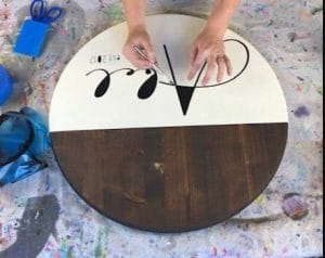 using an xacto knife to weed stenciled wood sign