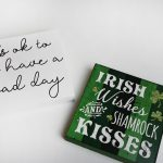 Dollar Tree Irish wishes and shamrock kisses turned into a white painted sign reading it's ok to have a bad day