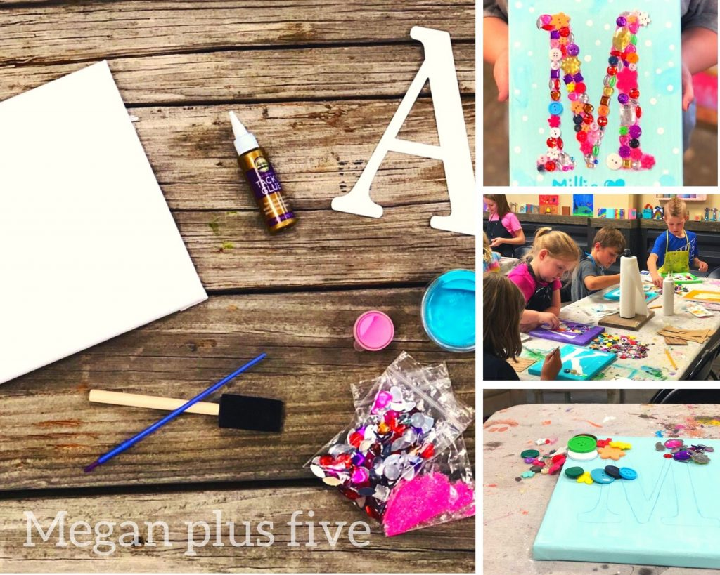 """DIY craft kit for canvas letter art for kids. 8""""x10"""" white canvas, teal container of paint, pink container of paint, black 1/2"""" foam sponge brush with wood handle, blue single use paintbrush, sample size container of tacky glue, white letter A from cardstock. Also pictured are kids crafting in a craft studio, kids finished art work of the letter M with embellishments of buttons and rhinestones, scattered assorted colors of rhinestones and buttons. Pallet style wood background"""