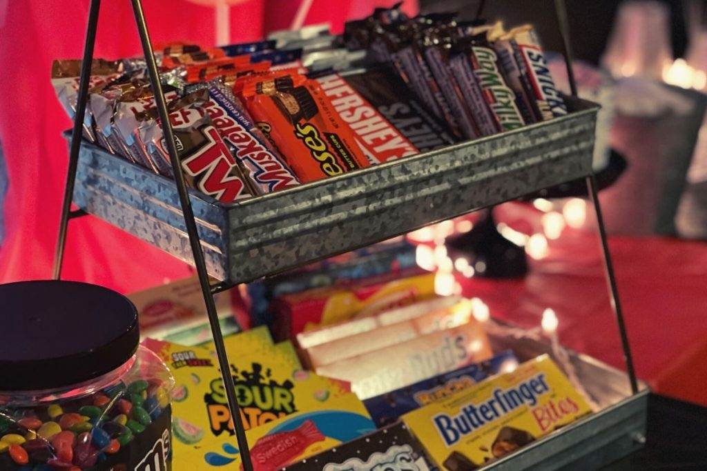 rectangular galvanized tiered tray holding theatre candy for a birthday party.