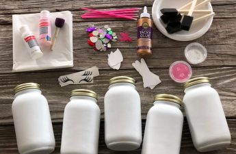 white painted mason jars, extra fine hot pink glitter, foam dabbers, eyelash decals, cardstock unicorn horns and ears, pink and white acrylic paint, small pink paintbrushes, rhinestones. Kids DIY craft kit