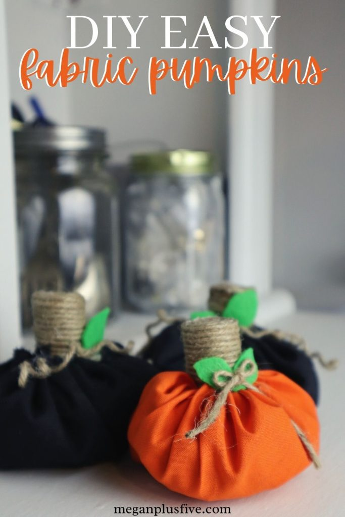 diy fabric pumpkins from scrap fabric. Orange and black scrap fabric handmade pumpkins with twine wrapped cork stems, green felt leaves, curly twine vines and a twine bow easy craft tutorial